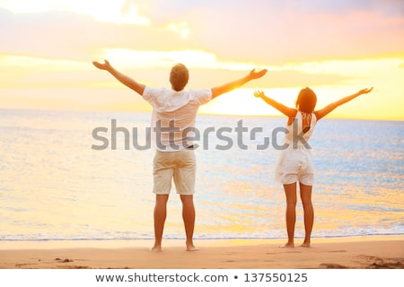 Free happy elated beach woman in freedom joy concept Stock photo © Maridav
