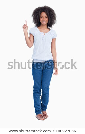 Attractive young woman raising her finger in the air against a white background Stock photo © wavebreak_media