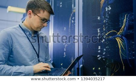 человека используя ноутбук проверить серверы центр обработки данных строительство Сток-фото © wavebreak_media