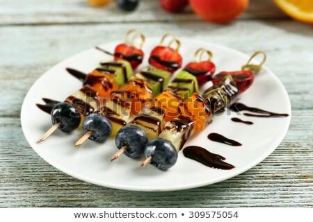 Gyümölcs nyárs csokoládé mártás étel ananász Stock fotó © M-studio