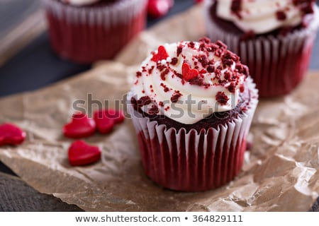 One chocolate cupcake with red icing Stock photo © tish1