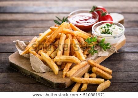 Patatine fritte ketchup legno sfondo cena pranzo Foto d'archivio © M-studio