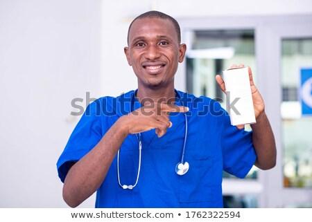 улыбаясь · мужчины · фармацевт · указывая · окна · таблетки - Сток-фото © wavebreak_media