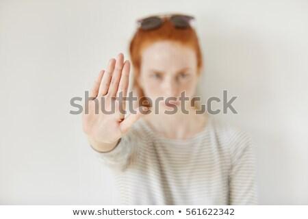 mulher · jovem · sinal · de · parada · isolado · branco · menina - foto stock © dacasdo