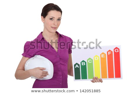 craftswoman holding an energy consumption label stock photo © photography33