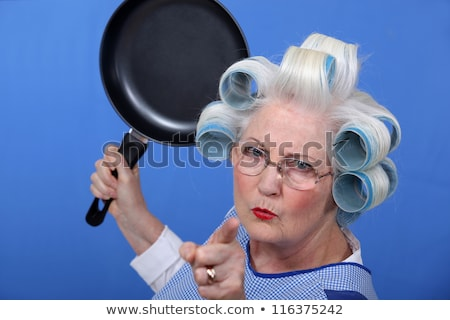 Angry old woman with a frying pan Stock photo © photography33