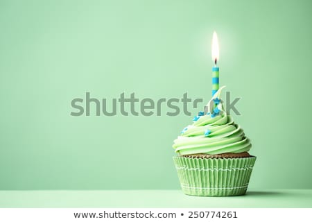 Birthday cupcake with green candle Stock photo © aladin66