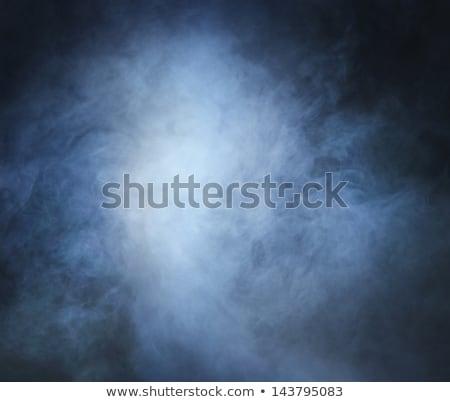 Burning cigarette with smoke on blue background  Stock photo © hanusst