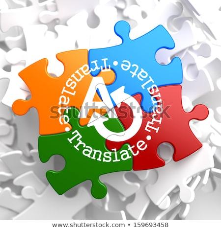 translating concept on multicolor puzzle stock photo © tashatuvango