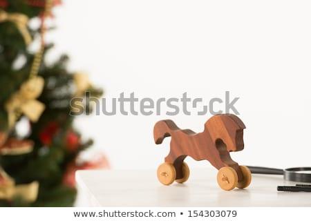 vintage wooden horse on santas work table stock photo © hasloo