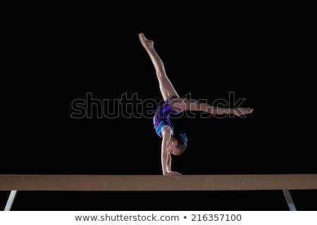 девушки стойка на руках студию изолированный черный женщину Сток-фото © meinzahn