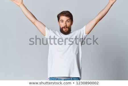 Muscular tattooed man with hands raised up  Stock photo © amok
