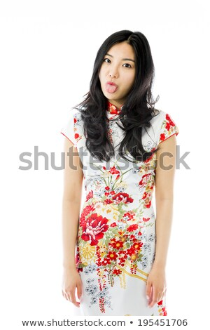 asian young woman poking out tongue towards camera isolated on colored background stock photo © bmonteny