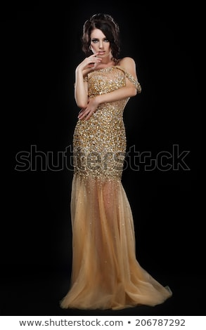 formal party glamorous fashion model in elegant golden dress over black stock photo © gromovataya