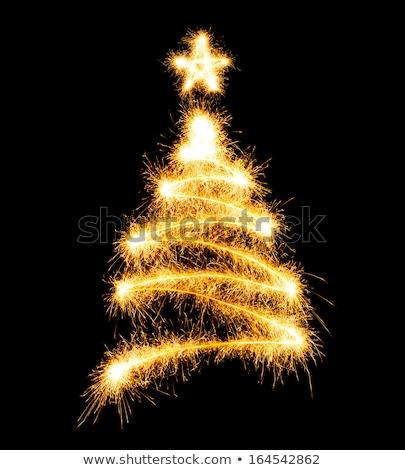 Christmas tree made by sparkler on a black Stock photo © vlad_star