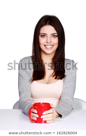 Beautiful young woman holding a cup of her favorite beverage, isolated on white Stock photo © deandrobot