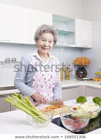 Idős ázsiai nő főzés konyha feketefehér Stock fotó © Witthaya