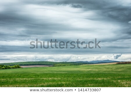dramatic rain clouds over countryside landscape stock photo © fesus