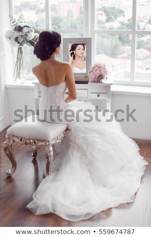 Сток-фото: Young Bride Looks In The Mirror Bridal Morning