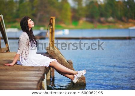 lány · meditál · tengerpart · tenger · égbolt · naplemente - stock fotó © klinker