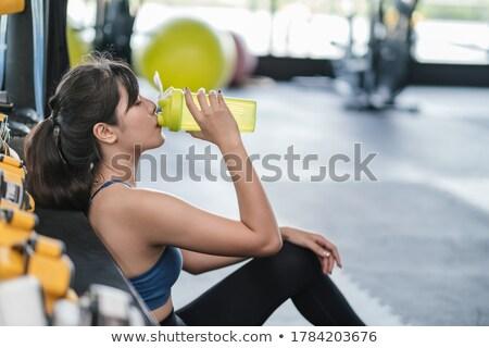 Body builder holding bottle with supplements in gym Stock photo © wavebreak_media