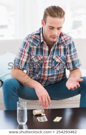 Adam tıp dışarı sehpa ev oturma odası Stok fotoğraf © wavebreak_media