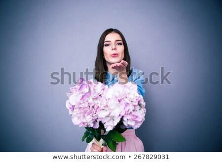 csábító · fiatal · nő · szürke · néz · kamera · közelkép - stock fotó © deandrobot