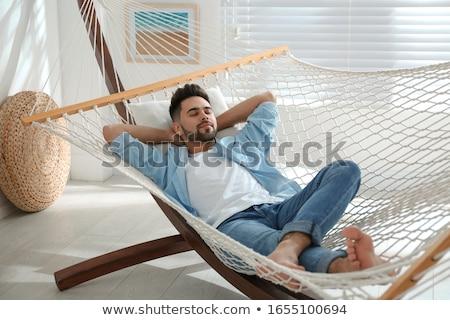 Man chilling in hammock. Stock photo © RAStudio