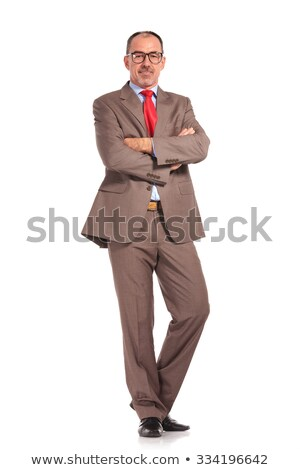 full body picture of a mature senior businessman standing Stock photo © feedough