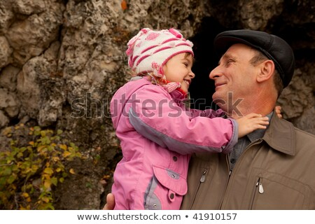 Grandfather and granddaughter near stone wall Stock photo © Paha_L