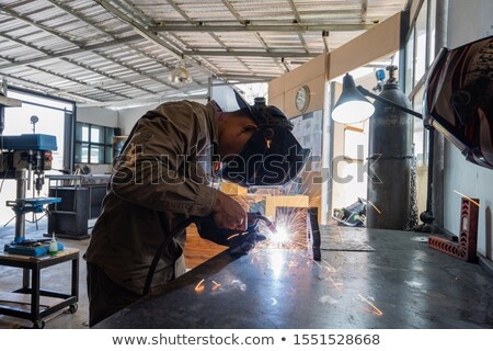 Cheerful repairman engineer. Stock photo © RAStudio