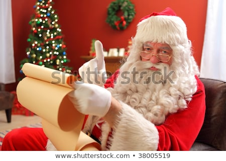 Santa's Naughty and Nice gift list with glasses and hat. Stock photo © rojoimages