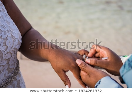 Stock photo: close up of lesbian couple hands with wedding ring