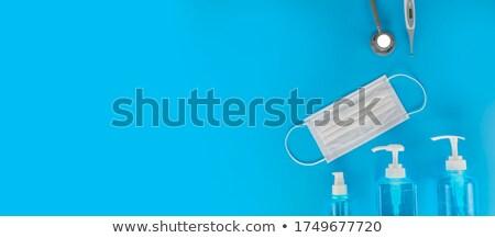 alcoholism medical concept on blue background stock photo © tashatuvango