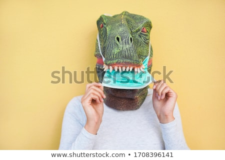 Stock photo: Woman with mask in funny concept