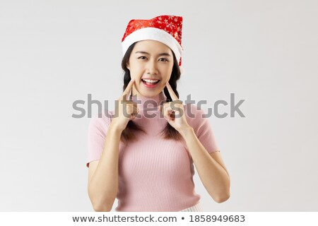 Beauty portrait of attractive smiling woman with decoration on cheek Stock photo © deandrobot