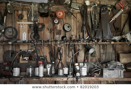 Many different old tools hanging on wall Stock photo © FreeProd