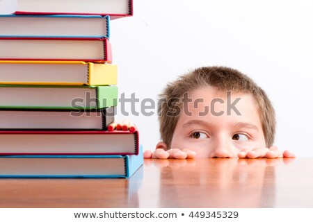 Thoughtful young schoolboy eyeing up his books Stock photo © ozgur