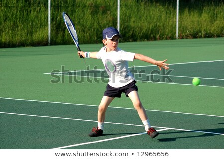 kids playing tennis in park stock photo © bluering