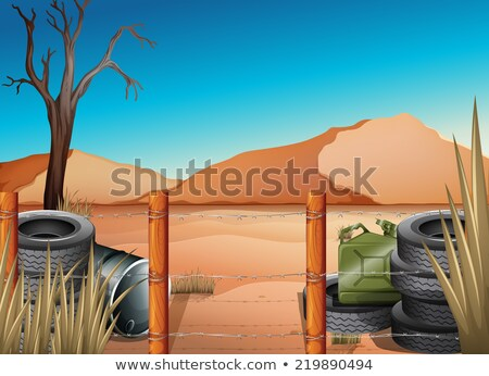 A desert with tires and a barbwire fence Stock photo © bluering