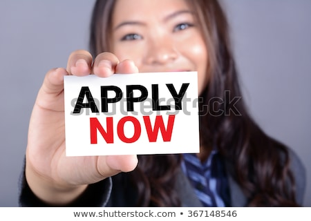 Business woman holding paper with Apply Now message Stock photo © stevanovicigor