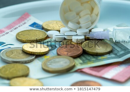 Drug Addicted Person With Syringe And Pills Stock photo © AndreyPopov