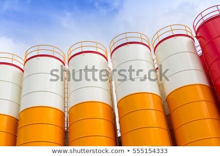 Industrial silos against the grey sky Stock photo © Klinker