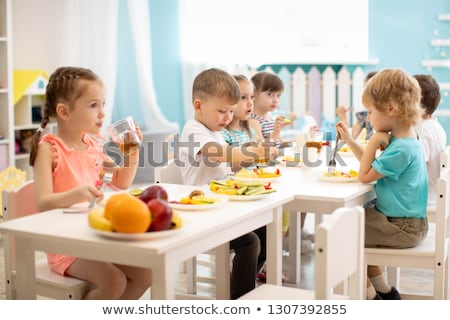 Children eating on table at canteen Stock photo © bluering