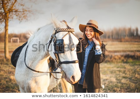Stockfoto: Pretty Lady Walking With Her Horse Friend
