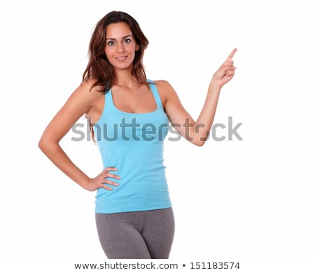 Smiling pretty fitness lady pointing to copyspace. stock photo © deandrobot