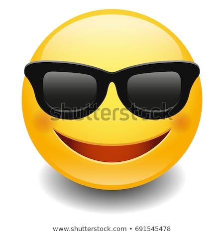 Emoji - smart smiling orange with glasses. Isolated vector. Stock photo © RAStudio