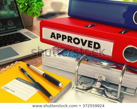 Red Office Folder with Inscription Approved. Stock photo © tashatuvango