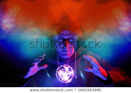 Man wearing suit in dark room illuminated by light Stock photo © julenochek