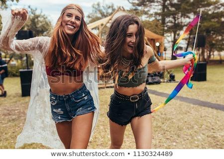 cheerful female friends enjoying at music festival stock photo © wavebreak_media